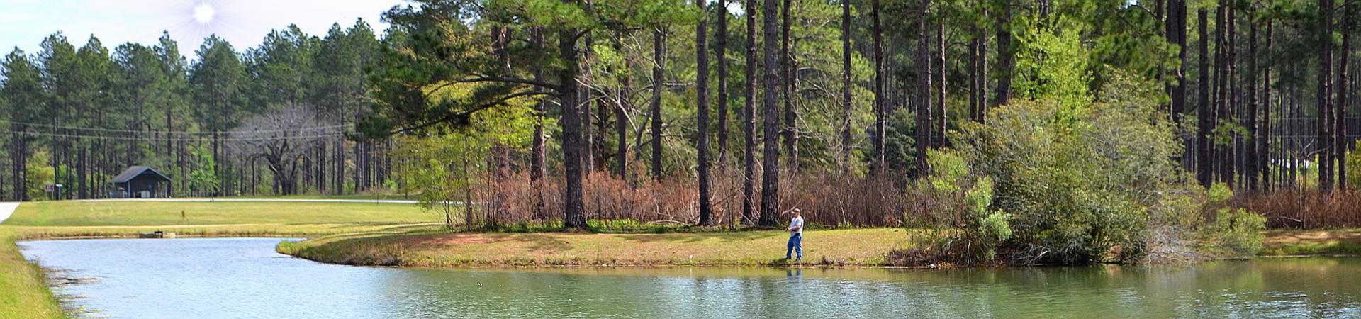 man fishing on lake at Paradise PFA