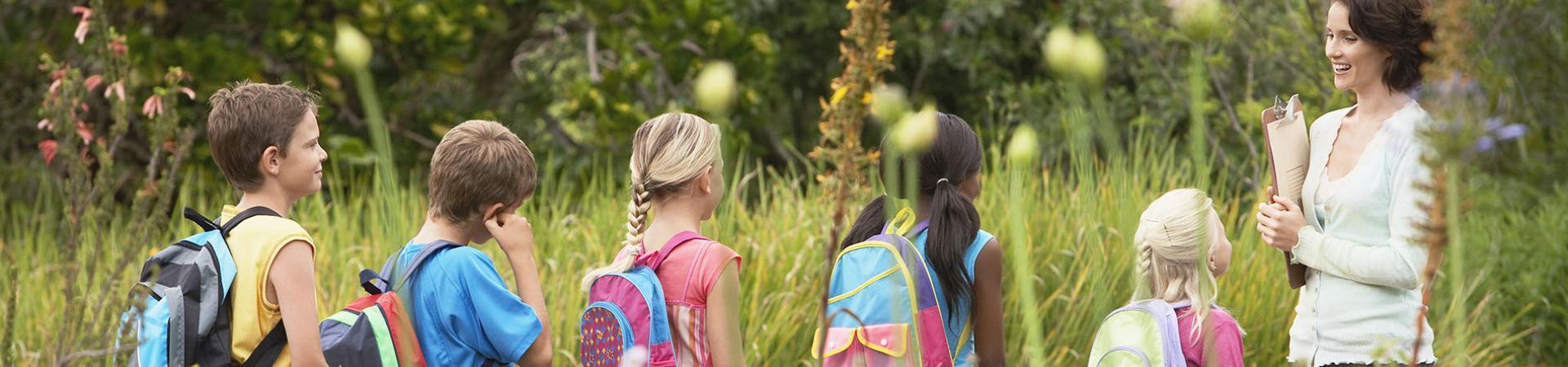 Kids and Teacher in Field